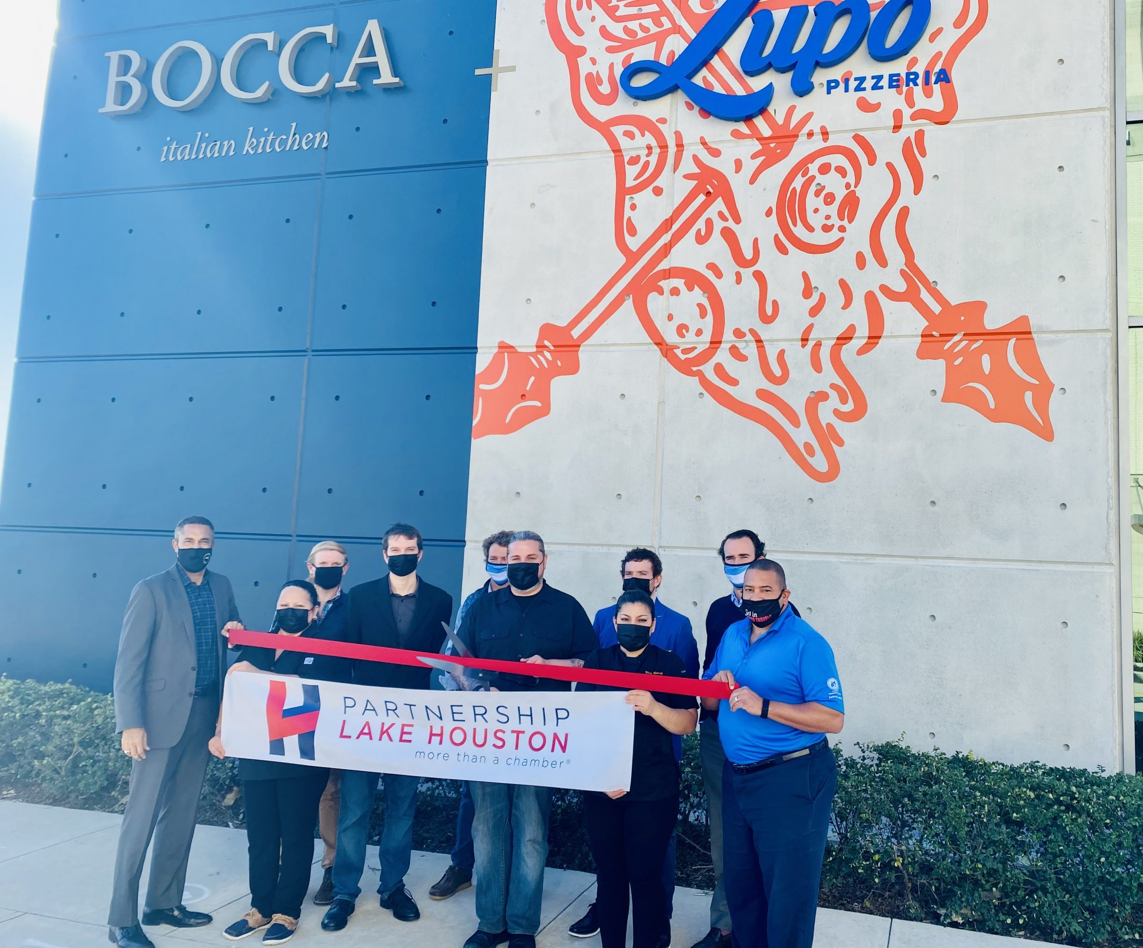 Chef Justin Turner, Director of Culinary Hospitality at McCord Development's Gastropub Productions poses with colleges, investors and Partnership Lake Houston ambassadors at Bocca Italian Kitchen and Lupo Pizzeria grand opening and ribbon cutting