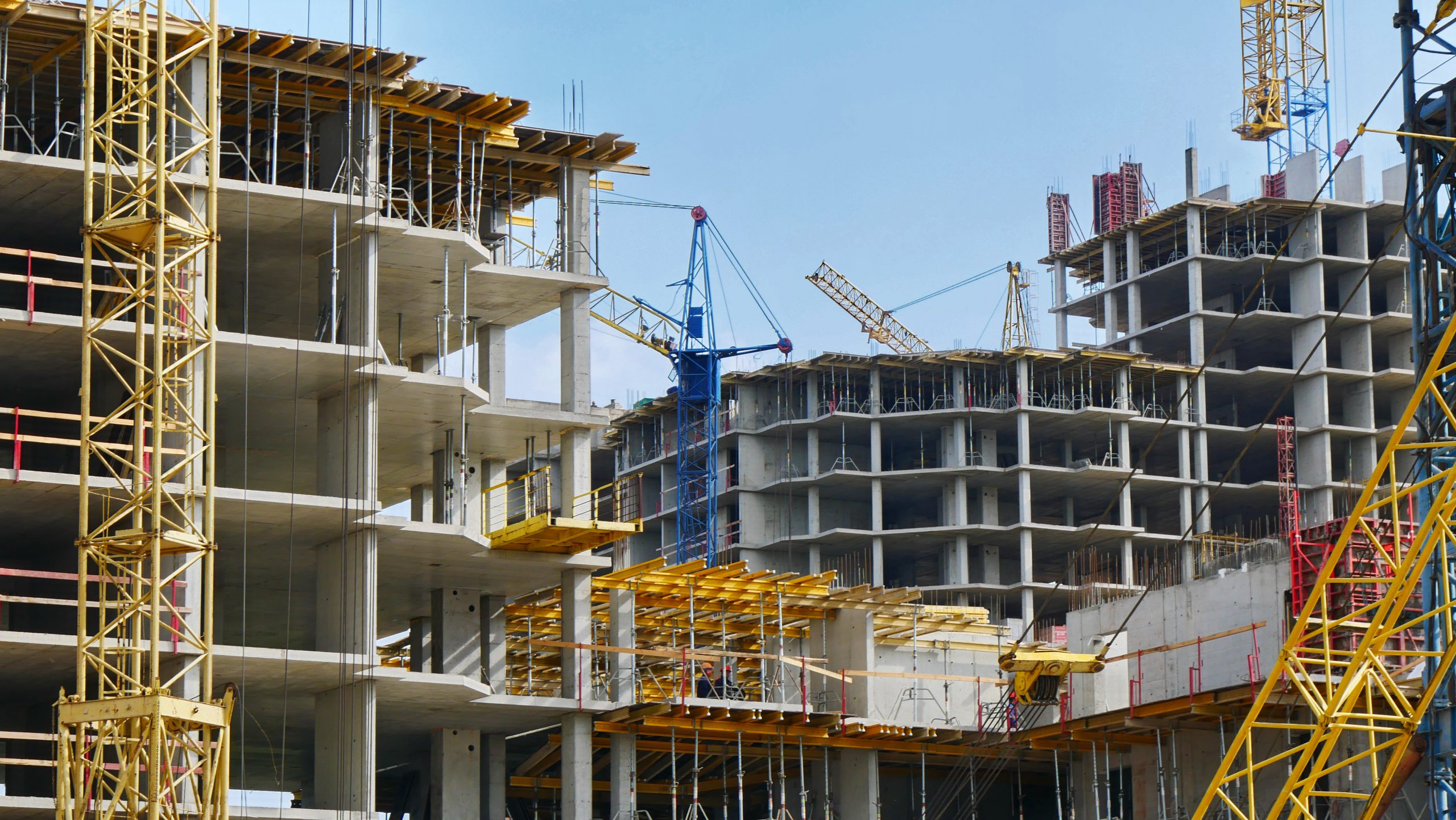 Construction,Site,Background.,Hoisting,Cranes,And,New,Multi-storey,Buildings.,I.ndustrial